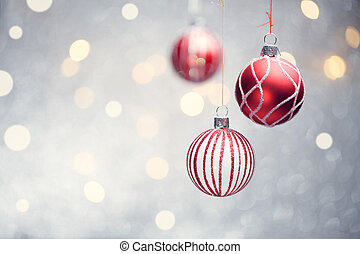 Image of three Christmas red balls on gray background with...