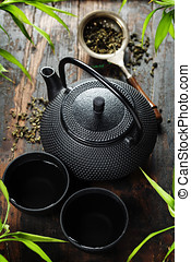 Image of traditional eastern teapot and teacups on wooden...