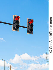 image of traffic light, the red light is lit. symbolic for...