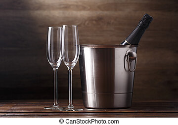 Image of two empty wine glasses, bottle of wine