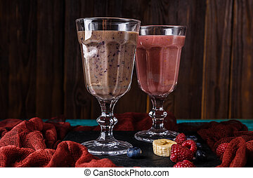 Image of two glasses with smoothies on table with cloth