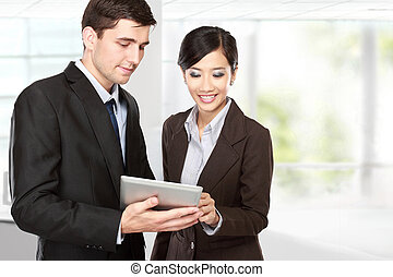 business partners using touchpad at meeting