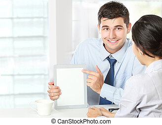 business partners using touchpad at meeting - Image of two...