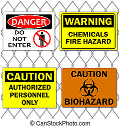 Image of various danger and caution signs on a chain link fence background.