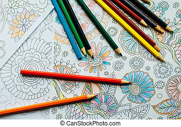 Image of woman coloring, adult coloring book trend, for stress relief. top view. colorer - antistress with colored pencils. Adult coloring books. The woman draws thereby relieves stress
