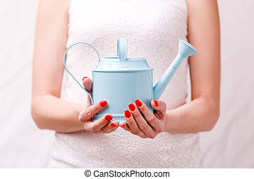 Image of woman holding watering can