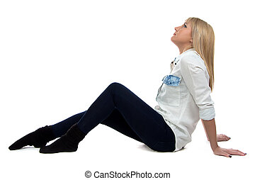 Image of woman sitting on the floor and looking up