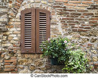 wooden window on a brick wall