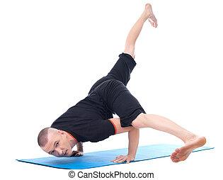 Image of yogi posing in studio looking at camera
