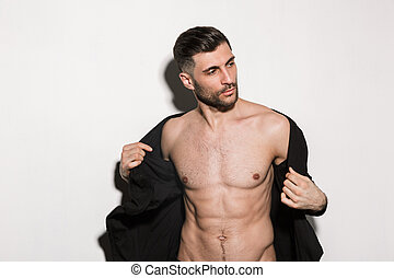 Image of young bearded handsome sexual man showing his six-...
