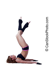 Image of young flexible gymnast training in studio