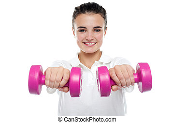 Image of young girl posing with dumbbells