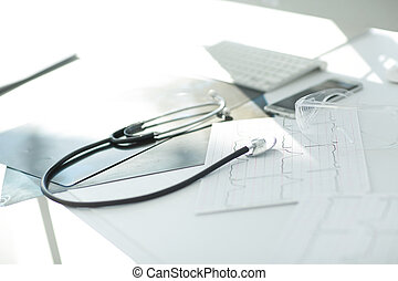image stethoscope and documents on the table at the surgeon