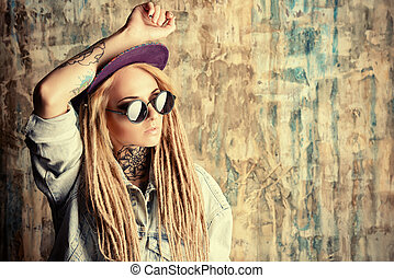 image trend - Modern teenage girl with blonde dreadlocks...
