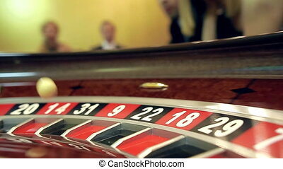 image with a casino roulette wheel with the ball on number close up