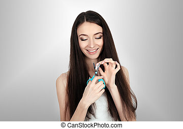 imagem composta, de, mulher sorridente, estalando, cigarro, em, metade