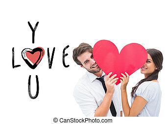 imagem composta, de, par, sorrindo, câmera, segurando, um, coração