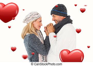 imagen compuesta, de, pareja, en, invierno, moda, se abrazar