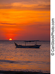 Images of the Sun setting with fishing boats