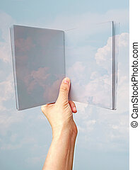 Imagination concept, hand hold book of blue sky and clouds