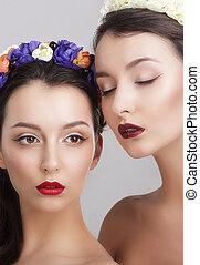 Imagination. Women in Garlands with Vernal Flowers