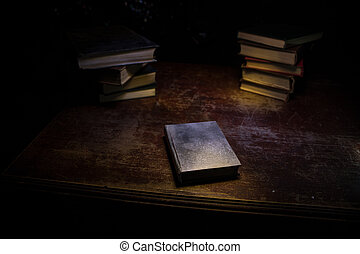 Imagine a picture book of an ancient book opened on a wooden table with a sparkling golden background. With magical power. magic. lightning around a glowing glowing book In the room of darkness