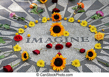 Imagine mosaic, full of flowers, at Strawberry Field in Central Park, New York, very hippie, flowers making the peace sign
