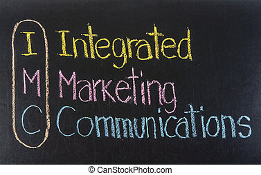 IMC acronym Integrated Marketing Communications, Marketing concept ,color chalk handwriting on blackboard