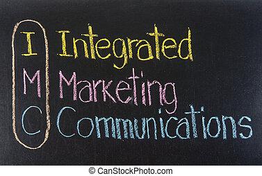 IMC acronym Integrated Marketing Communications, Marketing concept ,color chalk handwriting on blackboard