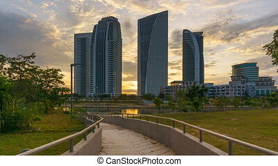 ime lapse of sunset at Putrajaya, Malaysia with government buildings, Pan Down