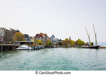 Imege of Evian-les-Bains city port in France taken from ferry boat on Lake Geneva