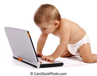 little boy playing with his laptop isolated on white