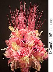 Imitation bouquet of beautiful flower on black background