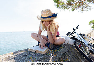 immagine, lettura donna, seawall