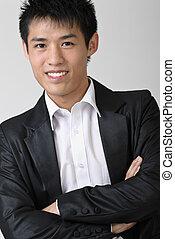 Immature business man of Asian, closeup portrait over studio...