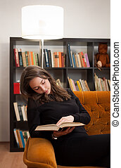 Immersed in reading.