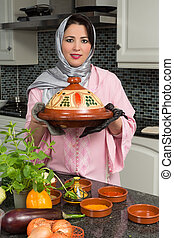 Immigrant lady with traditional dish - Moroccan immigrant...