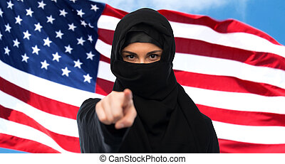 muslim woman in hijab pointing finger to you - immigration...