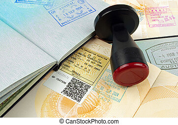 passport with immigration stamps on open pages