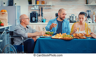 Immobilized man celebrating with family