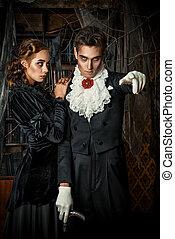 immortal - Beautiful man and woman vampires dressed in...