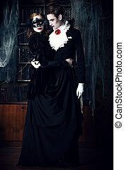 immortal couple - Gorgeous couple of vampires dressed in...