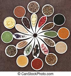 Immune boosting health food selection in porcelain dishes over lokta paper background.