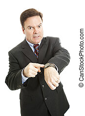 Impatient Businessman - Businessman impatiently pointing to...