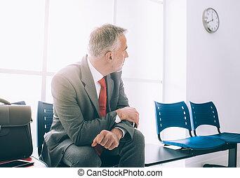 Impatient businessman waiting for a meeting - Impatient...
