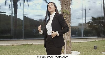Impatient businesswoman waiting for a client standing...