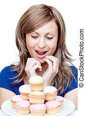 Impatient woman eating a cake