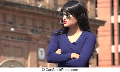 Impatient Woman Wearing Sunglasses And Wig