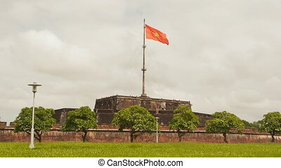 Imperial Royal Palace of Nguyen dynasty in Hue and flag....