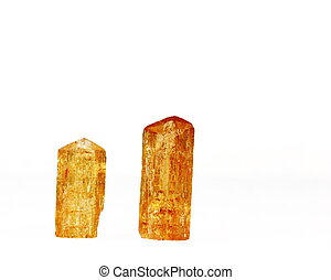 Two natural deep orange Imperial topaz crystals. Used in alternative medicine for the treatment of gout, blood disorders, TB and tissue regeneration. Birthstone for November